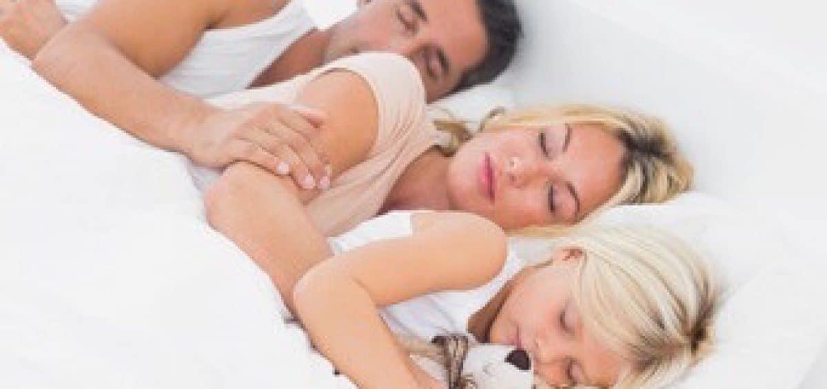 family sleeping tight