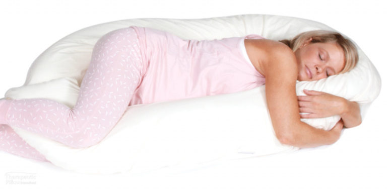 Woman using the CuddleUp Body Pillow Support available online and in-store at The Back and Neck Bed Shop
