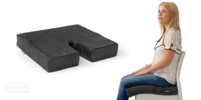 Woman sitting on the Diffuser Memory Foam Cushion available online and in-store at The Back and Neck Bed Shop