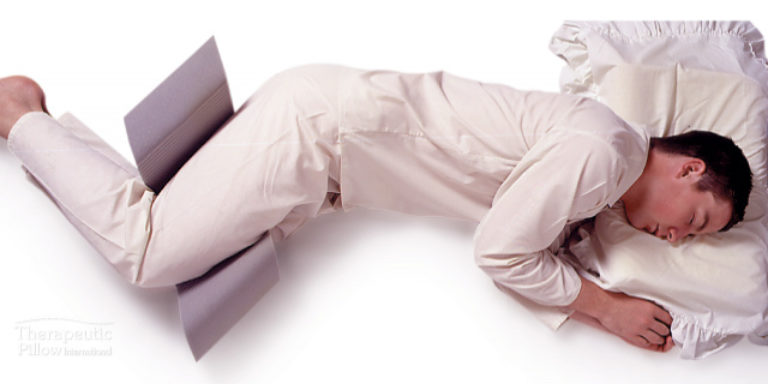 Man using the Side Sleeper Snoring Relief Leg Support available online and in-store at The Back and Neck Bed Shop