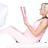 Pregnant woman relaxed on a wedge pillow