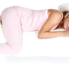 pregnant woman sleeping on a full body pillow