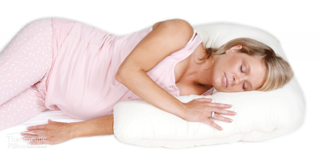 pregnant woman sleeping on a side snuggler body pillow