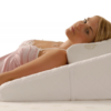 Woman lying on a Wedge pillow