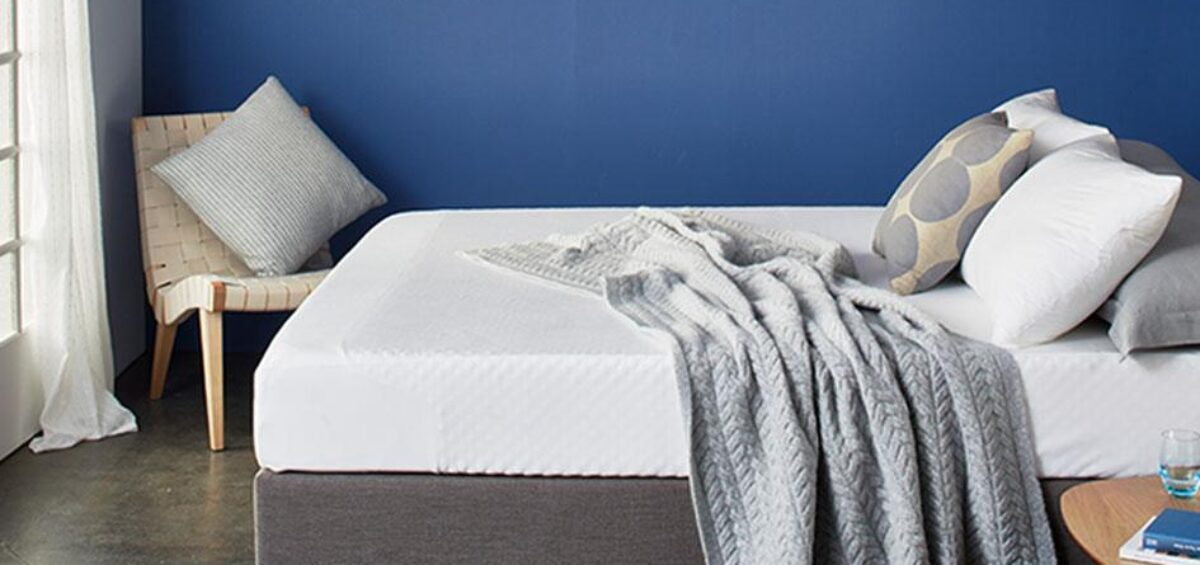 Bed with pillows and mattress cover