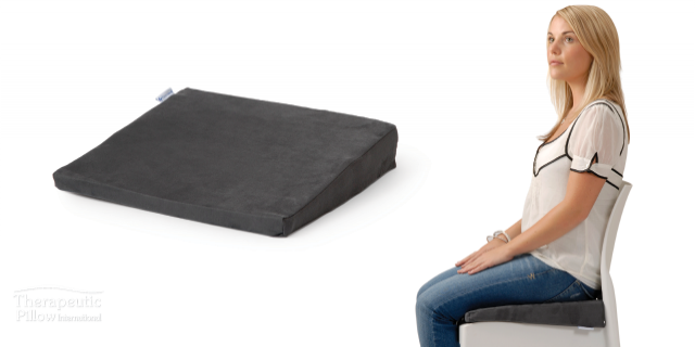woman seating on an angled posture seat cushion